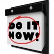 Do It Now Wall Calendar Urgent Demand Deadline - Stock Photo