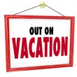 Out on Vacation Hanging Sign Store Office Closed - Stock Photo