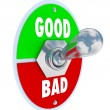 Good Vs Bad Words Toggle Switch Lever Judge Positive or Negative - Stock Photo