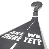 Are We There Yet words on a road leading to a big question mark — Stock Photo