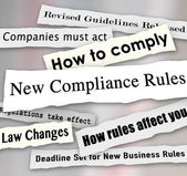 New Compliance Rules newspaper headlines words torn from the news — Stock Photo