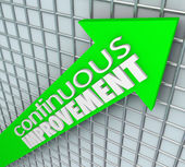 Continuous Improvement words on an arrow aiming upward — Stock Photo