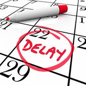 Delay word circled on a day or date on a calendar — Stock Photo