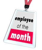Employee of the Month words on a name tag or badge — Stok fotoğraf