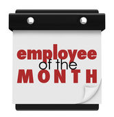 Employee of the Month words on a wall calendar — Stock Photo