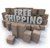 Free Shipping words surrounded by cardboard boxes — Stock Photo