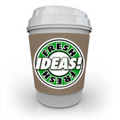 Fresh Ideas words on a coffee cup — Stock Photo