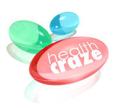 Health Craze words on vitamin supplement capsules — Stock Photo
