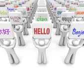 Osób posiadających znaki ze słowa powitania w różnych językach — Zdjęcie stockowe