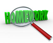 Homework word under a magnifying glass — Stock Photo
