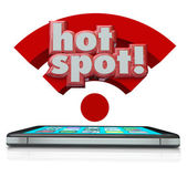 Hotspot word in 3d letters over a smart cell phone — Stock Photo