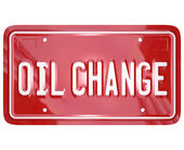 Oil Change words on red license plate — Stock Photo