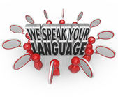 We Speak Your Language words surrounded by many people — Stock Photo