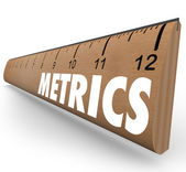 Metrics word on a wooden ruler — Stock Photo
