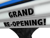 Grand Re-Opening Sign advertising a business — Stock Photo