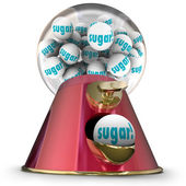 Sugar word on gum balls or candy  dispensed by a gumball machine — Stock Photo