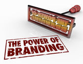 The Power of Branding words and a brand iron — Stock Photo