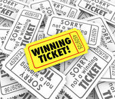 One winning ticket on pile of losing entries — Stock Photo