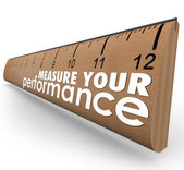 Measure Your Performance words on a wooden ruler — Stock Photo