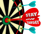 Stay on Target words on a dart board — 图库照片