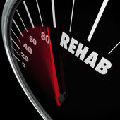 Rehab word on a speedometer to measure your cure — Stock Photo