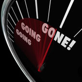 Going Going Gone words on a speedometer — Stock Photo