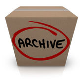 Archive word written on a cardboard box full of records — Foto Stock