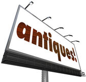 Antiques word on an outdoor billboard — Stock Photo