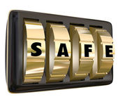 Safe word on gold dials of a lock — Stock Photo