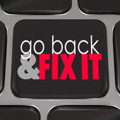 Go Back and Fix It words on a black computer keyboard — Stock Photo