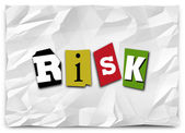 Risk word in cut out magazine letters — Stockfoto
