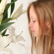 Girl and lilies — Stock Photo