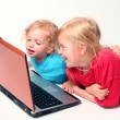 Royalty-Free Stock Photo: Playing on laptop