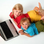 Playing on laptop — Stock Photo