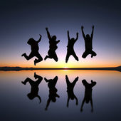 Happy friends jumping outdoor — Stock Photo