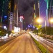 Street traffic in Hong Kong at night, timelapse in motion - Stock Photo