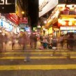 HONG KONG - SEPTEMBER 4, 2012: Street traffic in Hong Kong at night, timelapse. - Stock Photo