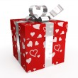 Red gift box with hearts & tag — Stock Photo #2043649