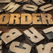 Order concept in wood type - ストック写真