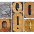 Letter Q in wood type blocks — Stock Photo #15628625