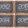 Stock Photo: Incoming years on blackboard