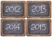 Incoming years on blackboard — Stok fotoğraf