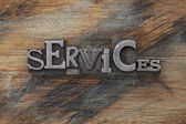 Services word in metal type blocks — Stock Photo