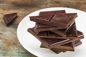 Dark chocolate pieces — Stock Photo