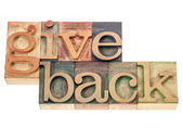Give back words in wood type — Stock Photo