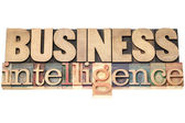Business intelligence in wood type — Stock Photo