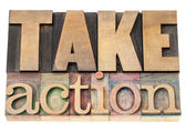 Take action in wood type — Stock Photo