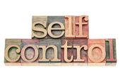 Self control in wood type — Stock Photo