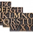 Alphabet abstract in wood type — Stockfoto