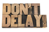 Do not delay in wood type — Stock Photo